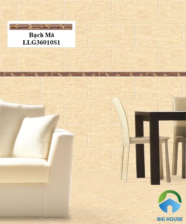 Sử dụng gạch kích thước nhỏ tone nâu trầm ốp điểm trên bức tường gạch giả đá vàng tạo không gian ấm cúng, gần gũi